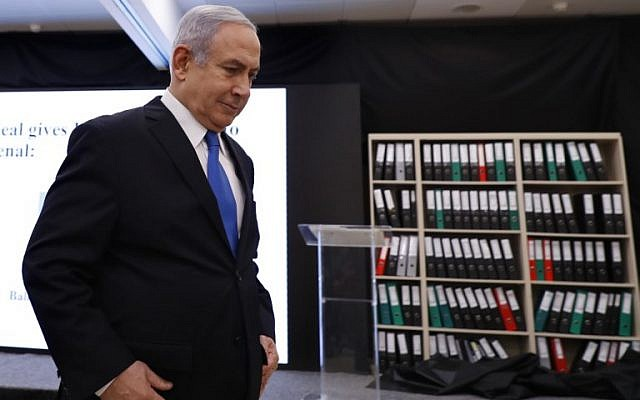 Prime Minister Benjamin Netanyahu departs after giving a speech on files obtained by Israel he says proves Iran lied about its nuclear program, at the Defense Ministry in Tel Aviv, on April 30, 2018. (AFP Photo/Jack Guez)