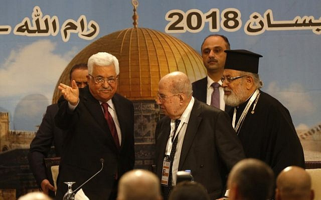 Palestinian president Mahmud Abbas (L) gestures during the Palestinian National Council meeting in Ramallah on April 30, 2018. (AFP/Abbas Momani)