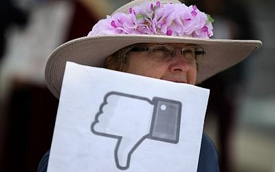 A protester with the group 'Raging Grannies' holds a sign during a demonstration outside of Facebook headquarters on April 5, 2018 in Menlo Park, California. (Justin Sullivan/Getty Images/AFP)