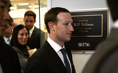 Facebook CEO Mark Zuckerberg (C) leaves after a meeting with US Sen. Bill Nelson (D-FL), ranking member of the Senate Committee on Commerce, Science, and Transportation, April 9, 2018, on Capitol Hill, in Washington, DC. (Alex Wong/Getty Images/AFP)