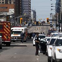 Law enforcement and first responders on scene at Yonge St. at Finch Ave. after a van plows into pedestrians April 23, 2018, in Toronto, Ontario, Canada. A suspect is in custody after a white van collided with multiple pedestrians. (Cole Burston/Getty Images/AFP)