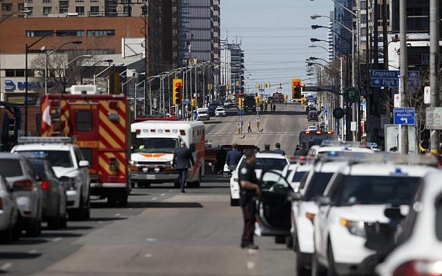 Law enforcement and first responders on scene at Yonge St. at Finch Ave. after a van plows into pedestrians April 23, 2018 in Toronto, Ontario, Canada. A suspect is in custody after a white van collided with multiple pedestrians.   (Cole Burston/Getty Images/AFP)