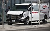 Police inspect a van suspected of being involved in a collision killing 10 people at Yonge St. and Finch Ave. on April 23, 2018, in Toronto, Canada. (Cole Burston/Getty Images/AFP)