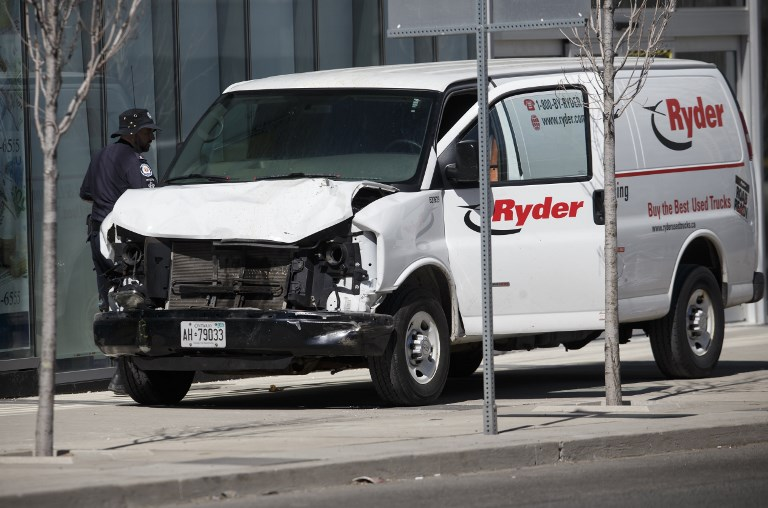 f363505e64 Police inspect a van suspected of being involved in a collision killing 10  people at Yonge