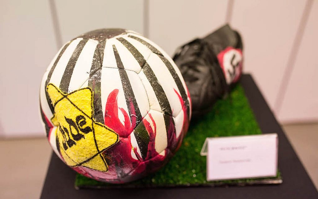The exhibition at River Plate's museum includes six illustrated soccer balls. This one was by Gustavo Nemirovsky. (Tabare da Ponte/Courtesy of 'No Fue un Juego' via JTA)