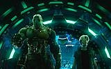 """Movie characters Aech, left, and Parzival in a scene from """"Ready Player One,"""" a film by Steven Spielberg. (Warner Bros. Pictures via AP)"""