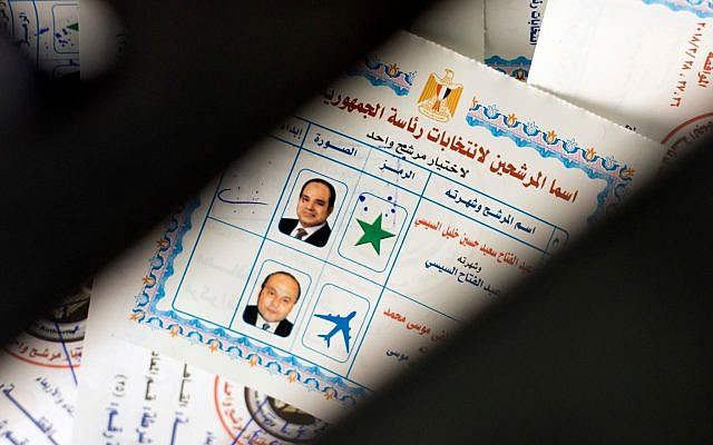 Ballots with photos and names of presidential candidates Abdel-Fattah el-Sissi, at top, and Moussa Mustafa Moussa, are visible inside a ballot box at a polling station, in Cairo, Egypt, March 26, 2018.  (Amr Nabil/AP)