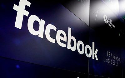 In this March 29, 2018 photo, the logo for Facebook appears on screens at the Nasdaq MarketSite in New York's Times Square. (AP Photo/Richard Drew, File)