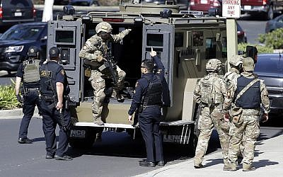 Armed law enforcement personnel exit an armored vehicle outside YouTube headquarters, in San Bruno, California, April 3, 2018. (Marcio Jose Sanchez/AP)