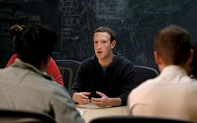 In this Nov. 9, 2017 photo, Facebook CEO Mark Zuckerberg meets with a group of entrepreneurs and innovators. (AP Photo/Jeff Roberson, File)