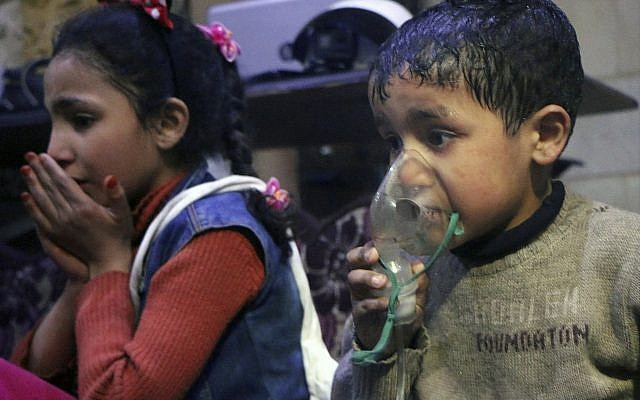 This image released Sunday, April 8, 2018 by the Syrian Civil Defense White Helmets, shows a child receiving oxygen through respirators following an alleged poison gas attack in the rebel-held town of Douma, near Damascus, Syria. Syrian rescuers and medics said the attack on Douma killed at least 40 people. (Syrian Civil Defense White Helmets via AP)