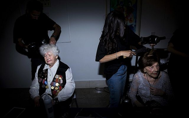 Holocaust survivors get their hair done during a Beauty Heroines event in Ramat Gan, Israel, Monday, April 9, 2018. (AP Photo/Oded Balilty)
