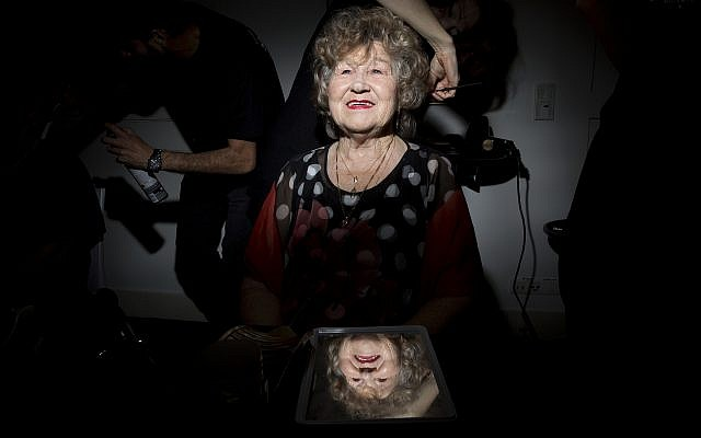 Holocaust survivor Shoshana Reshef, 82, gets her hair done during a Beauty Heroines event in Ramat Gan, Israel, Monday, April 9, 2018. AP Photo/Oded Balilty)