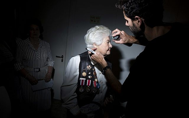 Soviet Jewish World War Two veteran Luba Nicolsky, 94, gets her hair done during a Beauty Heroines event in Ramat Gan, Israel, Monday, April 9, 2018. (AP Photo/Oded Balilty)