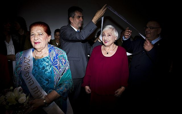 Holocaust survivors participate in a Beauty Heroines event in Ramat Gan, Israel, Monday, April 9, 2018. (AP Photo/Oded Balilty)