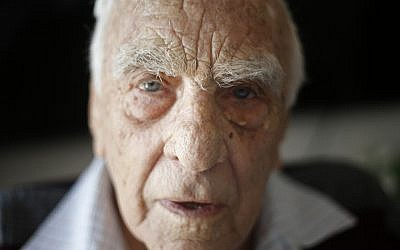 In this Tuesday, April 10, 2018 photo, Baruch Shub, a Holocaust survivor, poses for a photo at his apartment in a senior citizens' home in Kfar Saba, Israel. (AP Photo/Ariel Schalit)