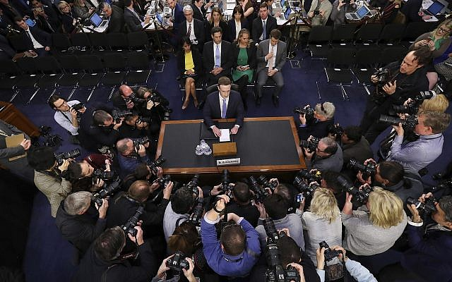 Facebook CEO Mark Zuckerberg arrives to testify before a joint hearing of the Commerce and Judiciary Committees on Capitol Hill, on April 10, 2018, about the use of Facebook data to target American voters in the 2016 election. (AP Photo/Pablo Martinez Monsivais)