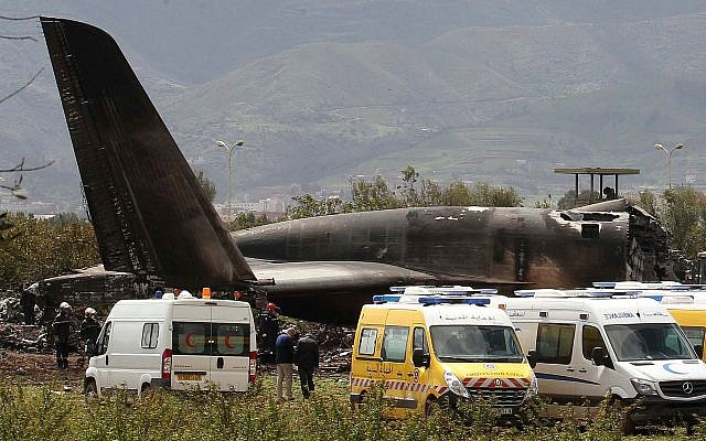 Firefighters and civil security officers work at the scene of a fatal military plane crash in Boufarik, near the Algerian capital, Algiers, on April 11, 2018. (AP Photo/Anis Belghoul)