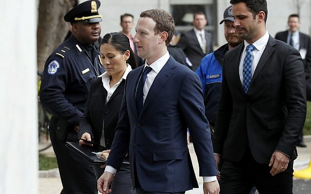Facebook CEO Mark Zuckerberg, center, arrives to testify before a House Energy and Commerce hearing on Capitol Hill in Washington on April 11, 2018, about the use of Facebook data to target American voters in the 2016 election. (AP Photo/Alex Brandon)