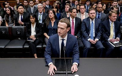 Facebook CEO Mark Zuckerberg arrives to testify before a House Energy and Commerce hearing on Capitol Hill in Washington on April 11, 2018, about the use of Facebook data to target American voters in the 2016 election and data privacy. (AP Photo/Andrew Harnik)