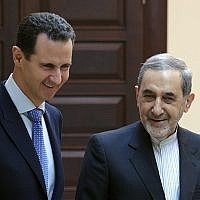 Syrian president Bashar Assad, left, meets with Ali Akbar Velayati, a top foreign policy adviser to Iran's Supreme Leader Ali Khamenei, in Damascus, Syria, April 12, 2018. (SANA via AP)