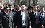 Poland's President Andrzej Duda, left, and Israel's President Reuven Rivlin, center, walk in the March of the Living, a yearly Holocaust remembrance march between the former death camps of Auschwitz and Birkenau, in Oswiecim, Poland, on Thursday, April 12, 2018. (AP Photo/Czarek Sokolowski)