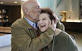 In this Wednesday, April 11, 2018, photo, childhood Holocaust survivors Simon Gronowski and Alice Gerstel Weit embrace at the Los Angeles Holocaust Museum. (AP Photo/Reed Saxon)