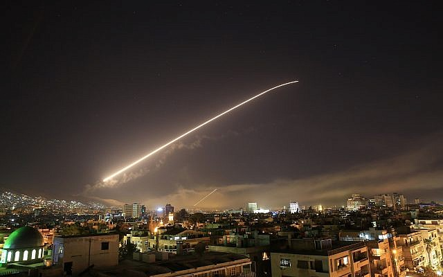 The Damascus sky lights up missile fire, as the US launches an attack on Syria targeting different parts of the capital, early Saturday, April 14, 2018. (AP Photo/Hassan Ammar)