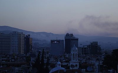 Smoke rises after airstrikes targeting different parts of the Syrian capital Damascus, Syria, early on April 14, 2018.  (AP Photo/Hassan Ammar)