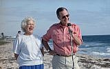 In this Nov. 14, 1988, file photo, President-elect George H.W. Bush and his wife, Barbara, are shown during a morning beachfront news conference in Gulf Stream, Fla. (AP Photo/Kathy Willens, File)