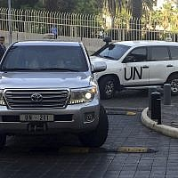 United Nations vehicles carry the team of the Organization for the Prohibition of Chemical Weapons (OPCW), arrive at a hotel on April 14, 2018, ahead of an investigation into whether President Bashar Assad used chemical weapons against civilians, in Damascus, Syria. (AP Photo/Bassem Mroue)