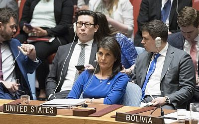 US Ambassador to the UN Nikki Haley listens as Syrian Ambassador to the UN Bashar Ja'afari speaks after a vote on a resolution during a Security Council meeting on the situation in Syria, on April 14, 2018, at United Nations headquarters. (AP Photo/Mary Altaffer)