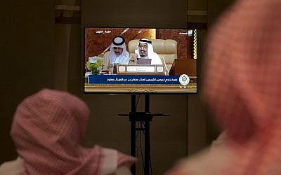 Reporters watch the speech of Saudi King Salman from a press room, during the opening of the Arab summit in Dhahran, Saudi Arabia, April 15, 2018. (AP Photo/Amr Nabil)