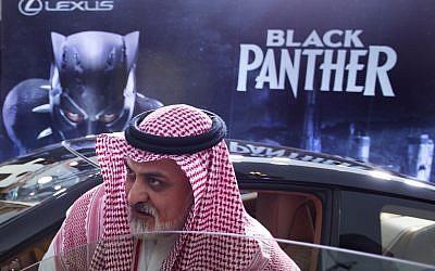 A visitor checks out a Lexus car, similar to a one used in the Black Panther film, that is on display outside an invitation-only screening, at the King Abdullah Financial District Theater, in Riyadh, Saudi Arabia, April 18, 2018. (AP Photo/Amr Nabil)