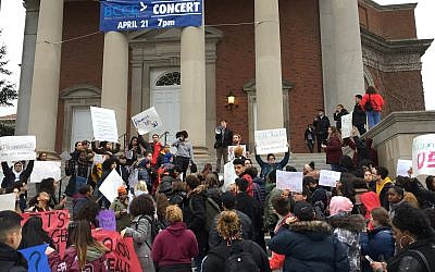 Syracuse University students gather outside Hendricks Chapel on Wednesday, April 18, 2018 to protest a video made by members of a now-suspended fraternity showing anti-Semitic, racist and sexist behavior in Syracuse, New York. (Lindsey Sabado/The Syracuse Newspapers via AP)