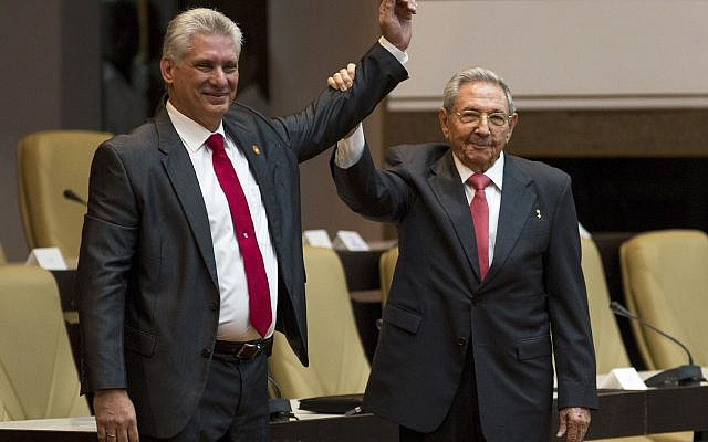Cuba's new president Miguel Diaz-Canel, left, and former president Raul Castro, raise their arms after Diaz-Canel was elected as the island nation's new president, at the National Assembly in Havana, Cuba, April 19, 2018. (Irene Perez/Cubadebate via AP)