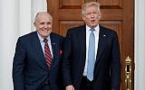 In this November 20, 2016, file photo, then-US President-elect Donald Trump, right, and former New York Mayor Rudy Giuliani pose for photographs as Giuliani arrives at the Trump National Golf Club Bedminster clubhouse in Bedminster, N.J. (AP Photo/Carolyn Kaster, File)