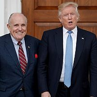 In this Nov. 20, 2016, file photo, then-US President-elect Donald Trump, right, and former New York Mayor Rudy Giuliani pose for photographs as Giuliani arrives at the Trump National Golf Club Bedminster clubhouse in Bedminster, N.J. (AP Photo/Carolyn Kaster, File)