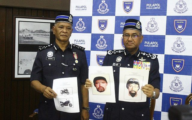 Inspector General of Royal Malaysian Police Mohamad Fuzi Harun, right, shows two images of suspects in the killing of a Hamas man during a press conference in Kuala Lumpur, Malaysia, Monday, April 23, 2018. (AP)