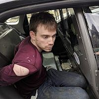 In this photo released by the Metro Nashville Police Department, Travis Reinking sits in a police car after being arrested in Nashville, Tenn., on April 23, 2018. (Metro Nashville Police Department via AP)