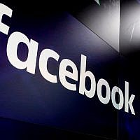 In this March 29, 2018, photo, the logo for Facebook appears on screens at the Nasdaq MarketSite in New York's Times Square. (AP Photo/Richard Drew)