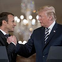 US President Donald Trump and French President Emmanuel Macron shake hands during a joint news conference in the East Room of the White House in Washington, Tuesday, April 24, 2018. (AP Photo/Andrew Harnik)