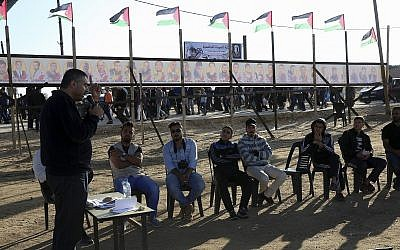 In this Monday, April 23, 2018 photo, trainer Tareq Isleem teaches Palestinian youths participating in a workshop about 'non-violent' resistance and 'peaceful' protests at a tent near the protest site near Gaza's border with Israel, east of Gaza City. (AP Photo/Adel Hana)