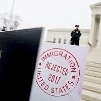"Poster sized enlargements of passports marked as ""rejected"" by United States Immigration are on display during an anti-Muslim ban rally as the Supreme Court hears arguments about whether US President Donald Trump's ban on travelers from several mostly Muslim countries violates immigration law or the Constitution, April 25, 2018, in Washington. (AP Photo/Andrew Harnik)"