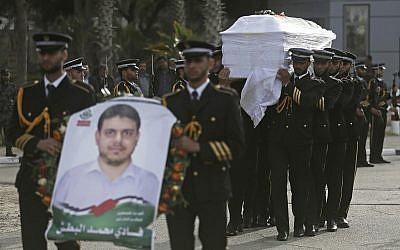 Hamas terror group members carry the coffin of Palestinian rocket and drone expert Fadi al-Batsh after his remains crossed into the Gaza Strip from Egypt April 26, 2018. (Khalil Hamra/AP)