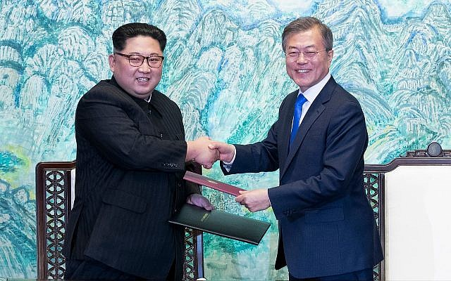 North Korean leader Kim Jong Un, left, and South Korean President Moon Jae-in shake hands after signing on a joint statement at the border village of Panmunjom in the Demilitarized Zone, South Korea, April 27, 201. (Korea Summit Press Pool via AP)