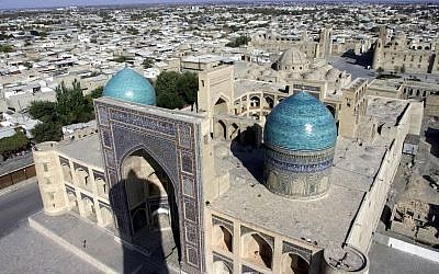 A general view of Bukhara, Uzbekistan, taken from the legendary Kalyan minaret with the Mir-I-Arab Madrassa in the foreground, November 21, 2001 (AP Photo/Mindaugas Kulbis)