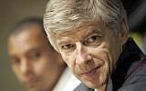 Arsenal's manager Arsene Wenger attends a news conference with Arsenal player Gilberto from Brazil, Monday, April 24 2006 (AP Photo/Fernando Bustamante)