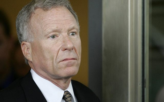 "Former White House aide I. Lewis ""Scooter"" Libby walks towards his car outside federal court in Washington, Tuesday, June 5, 2007, after he was sentenced for lying and obstructing the CIA leak investigation. (AP Photo/Charles Dharapak)"