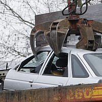 Illustrative photo of a wrecked car being lifted by a crane on January 30, 2009. (AP Photo/Joerg Sarbach)